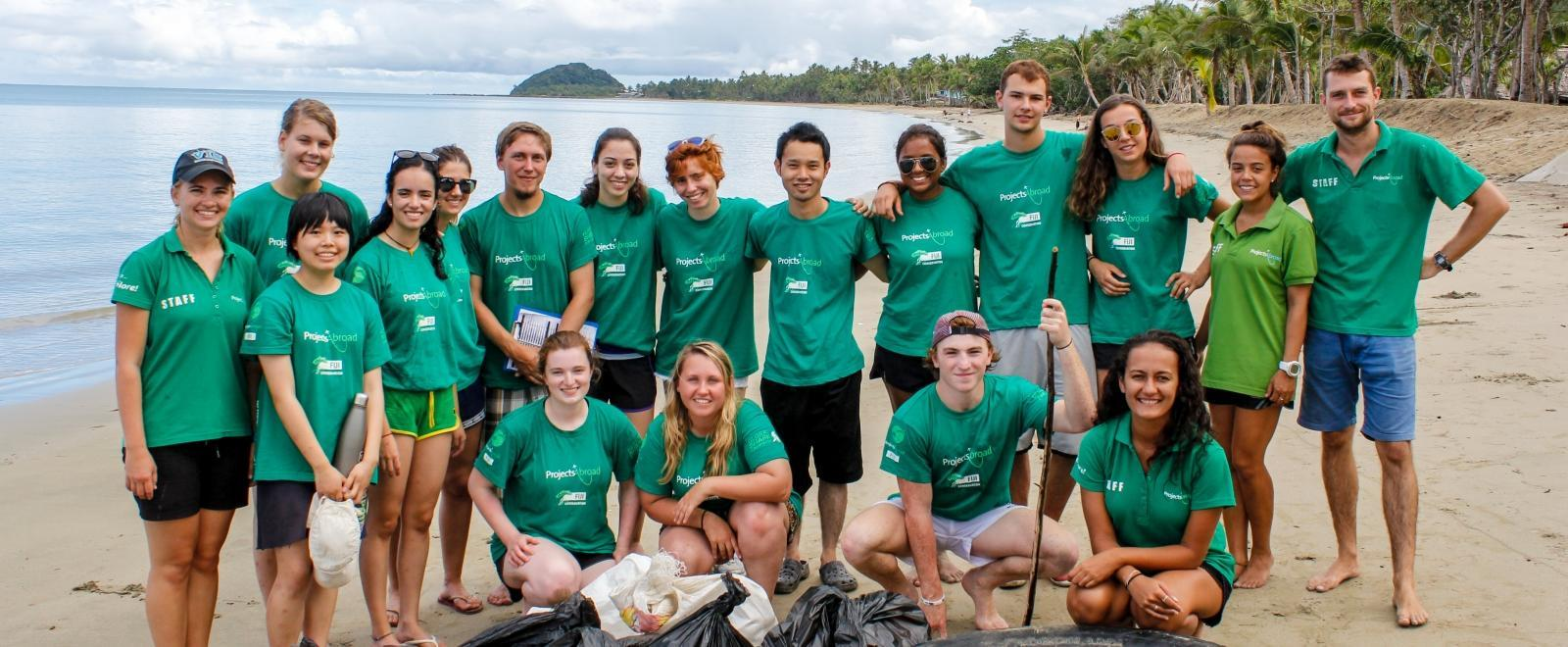 Projects Abroad volunteers pose after a successful beach clean up in Fiji.